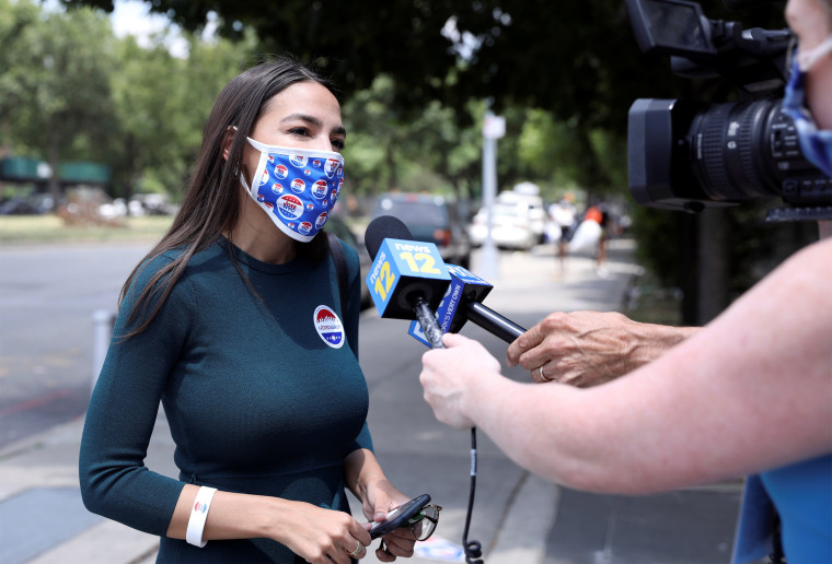 Image: U.S. Rep. AOC votes early in Democratic congressional primary election in New York City