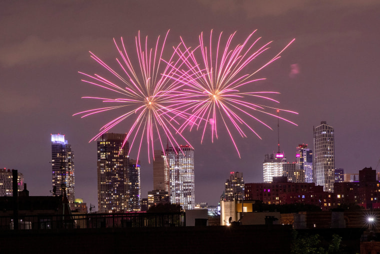 Image: Illegal fireworks illuminate the sky over the Bedford-Stuyvesant neighborhood of the Brooklyn borough of New York City, New York
