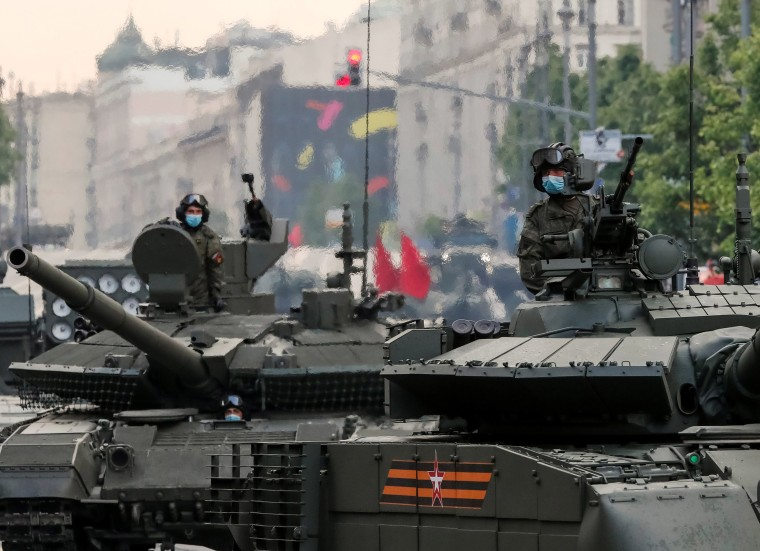 Image: Russian servicemen ride tanks before a rehearsal for the Victory Day parade in Moscow