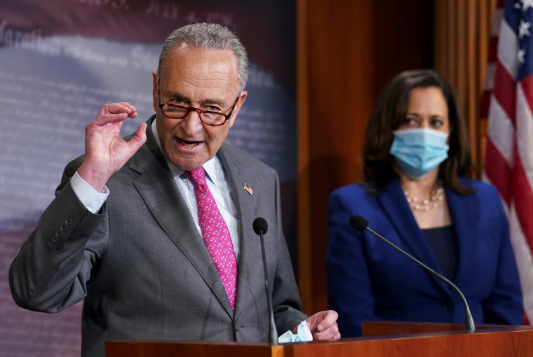 Image: Chuck Schumer and Kamala Harris speak on Capitol Hill in Washington