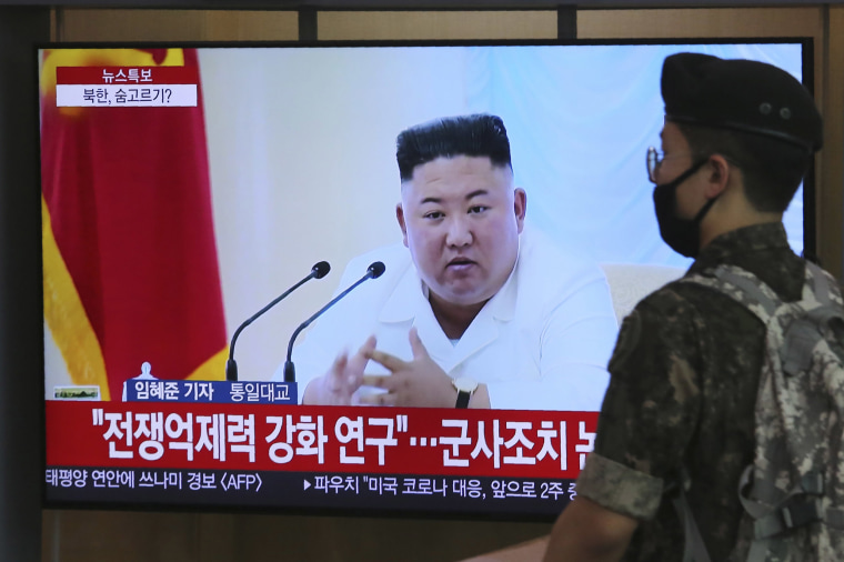 Image: A South Korean army soldier passes by a TV showing a file image of North Korean leader Kim Jong Un during a news program at the Seoul Railway Station in Seoul, South Korea