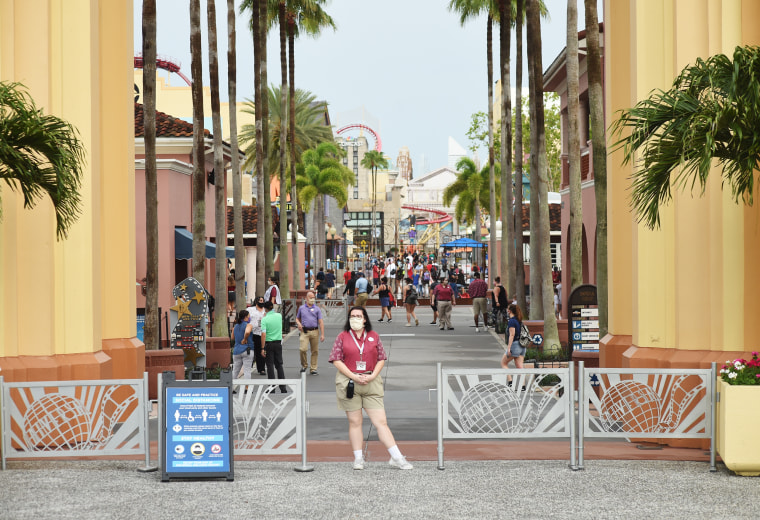 Park guests arrive at the Universal Studios theme park in Orlando, Fla.
