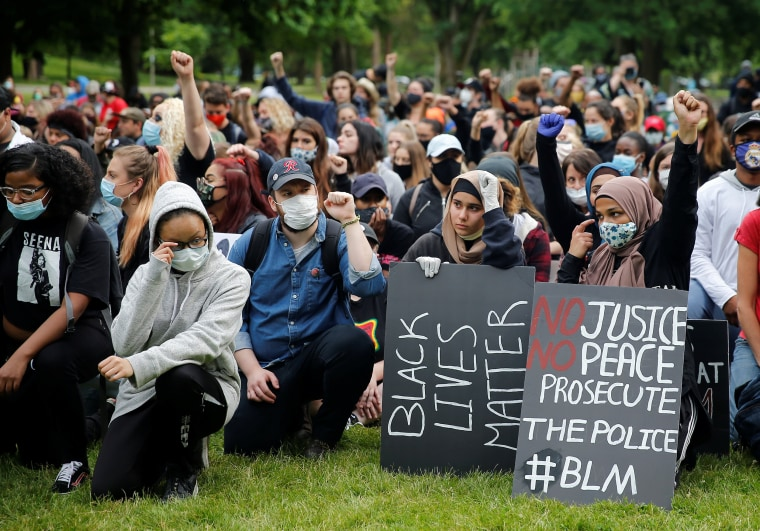 Black Lives Matter protesters take a knee during a rally in Tacoma, Wash., on June 5, 2020.