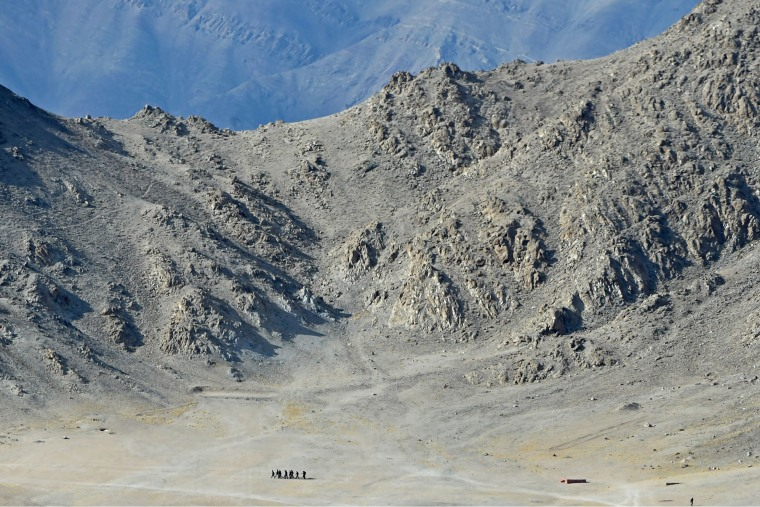 Image: Indian soldiers walk at the foothills of a mountain range near Leh, the joint capital of the union territory of Ladakh
