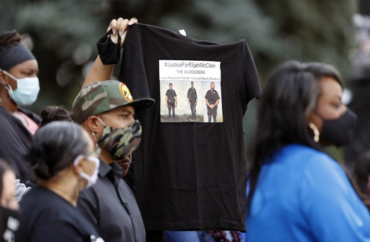 Image: A supporter holds up a shirt to call attention to the death of Elijah McClain in Aug. 2019 in Aurora, Colo