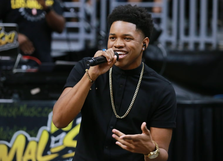 Nathan Davis Jr. performs during a WNBA basketball game in Los Angeles