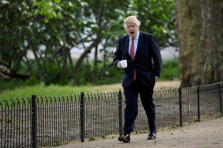 British Prime Minister Boris Johnson goes for a walk in Central London on May 11, 2020.