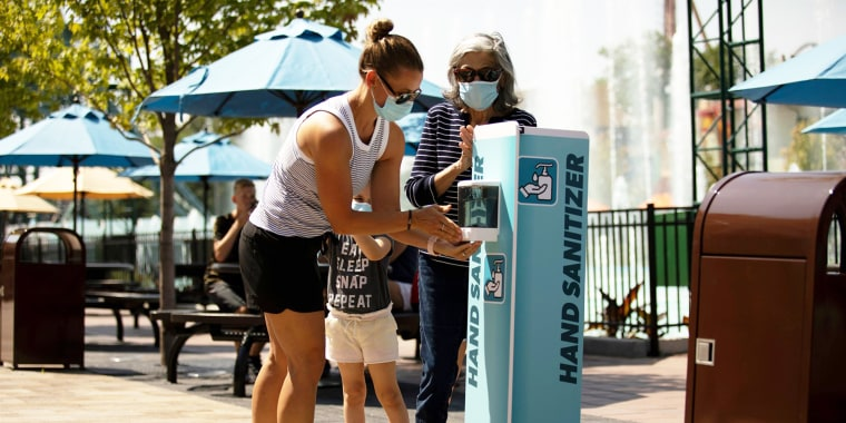 People use a hand sanitizing station in Kings Island for Orion Media Day in Mason, Ohio on July 1, 2020. Kings Island re-opened today under very strict and stringent procedures throughout the park to reduce the spread of coronavirus.