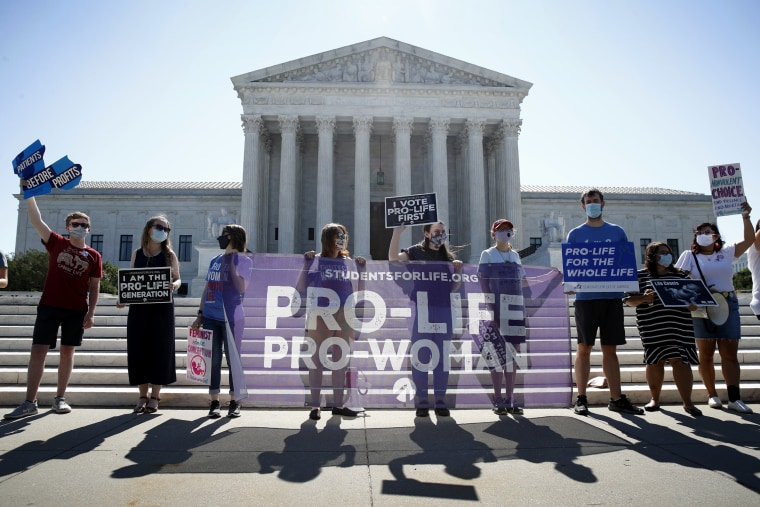 Image: Anti-abortion advocates wait outside of the Supreme Court for a decision in a Louisiana abortion case on June 29, 2020.