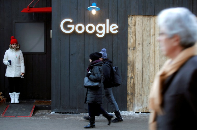 People walk past the logo of Google in Davos, Switzerland, on Jan. 22, 2020.