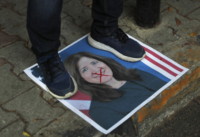 Image: A protester stands on a portrait of the U.S. Ambassador to Lebanon Dorothy Shea, outside the Lebanese Foreign Ministry on Monday.