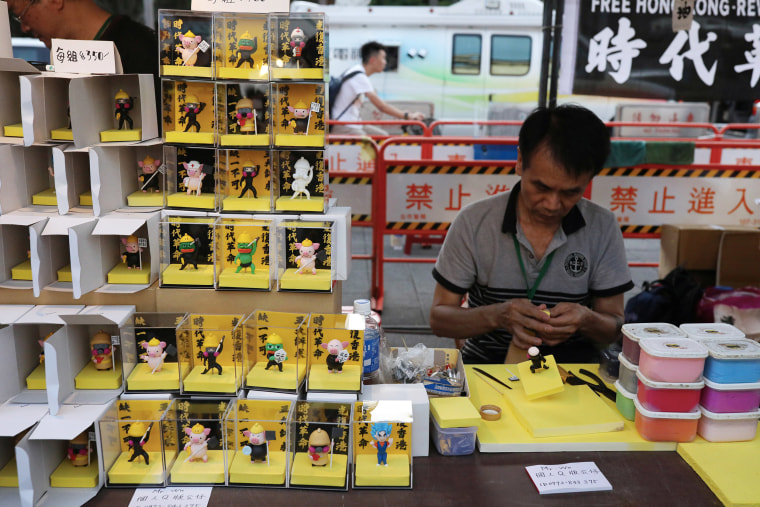 Image: A vendor crafts statues of Hong Kong protesters at a rally marking the one-year anniversary of the start of the protests in Hong Kong, at Liberty Square in Taipei