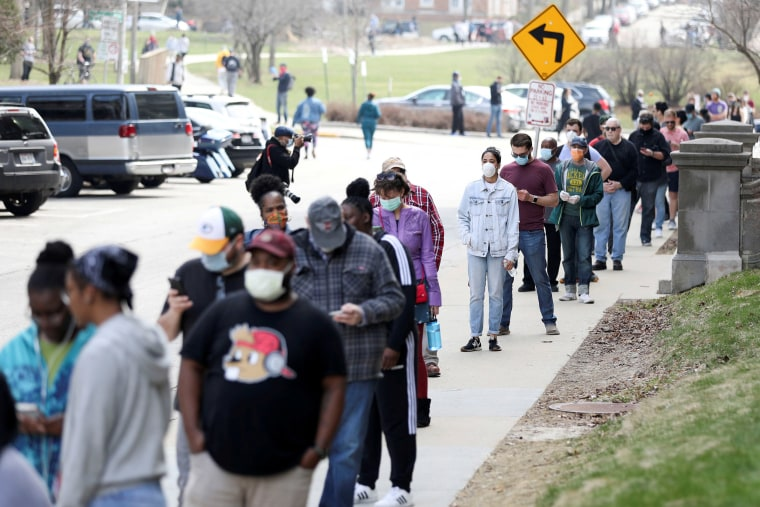 Image: Voters wait in line outside Riverside University High School to cast ballots during the presidential primary election in Milwaukee, Wisconsin.