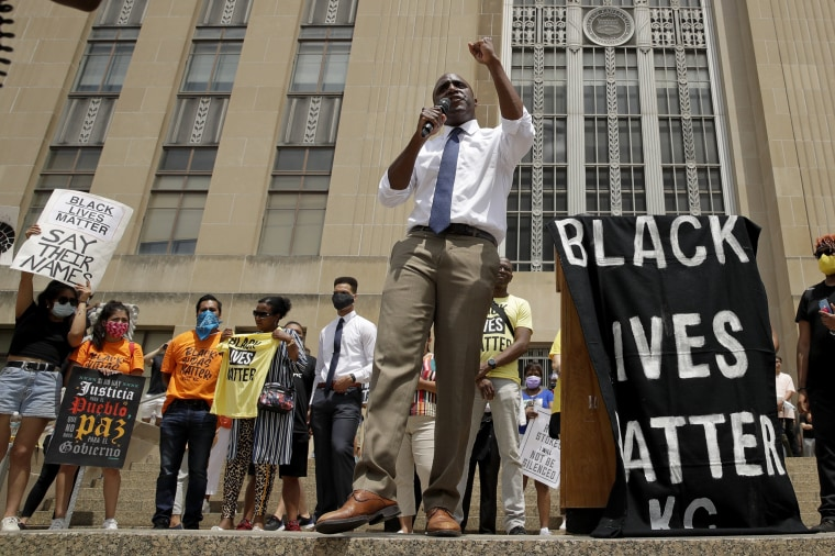 Mayor Quinton Lucas talks to demonstrators during a rally on the steps of city hall in Kansas City, Mo., on June 5, 2020.