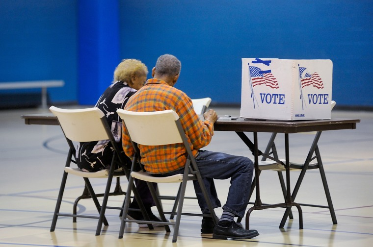 Image: An elderly couple reads a ballot prior to voting on Nov. 8, 2016 in Durham, North Carolina.
