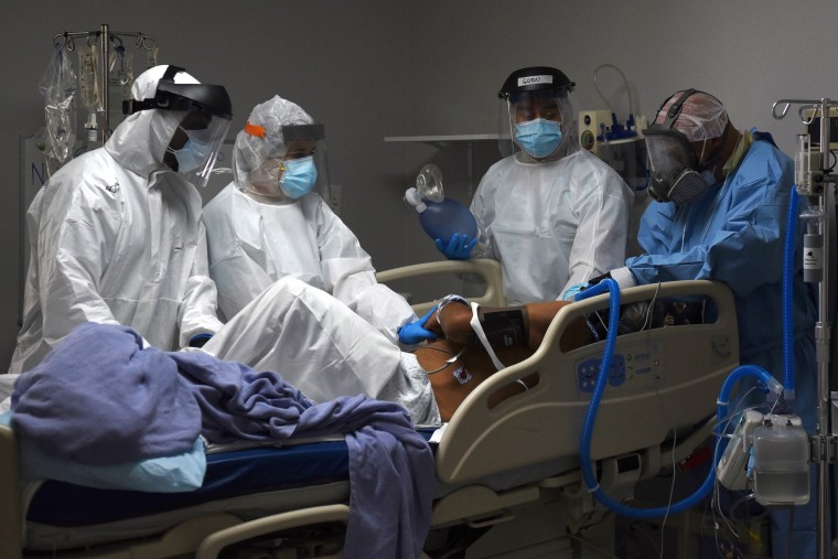 Medical workers prepare to intubate a COVID-19 patient at the United Memorial Medical Center in Houston, Texas, on June 29, 2020.