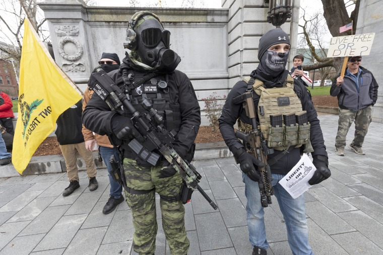Members of the Boogaloo Movement attend a demonstration against coronavirus lockdown measures at the New Hampshire State House in Concord on April 18, 2020.