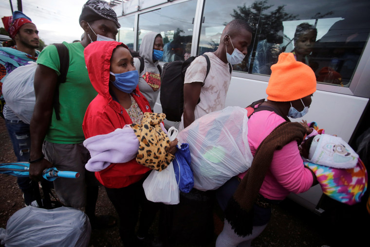 Image: Stranded migrants from Africa, Cuba and Haiti, are taken to a shelter in Tegucigalpa