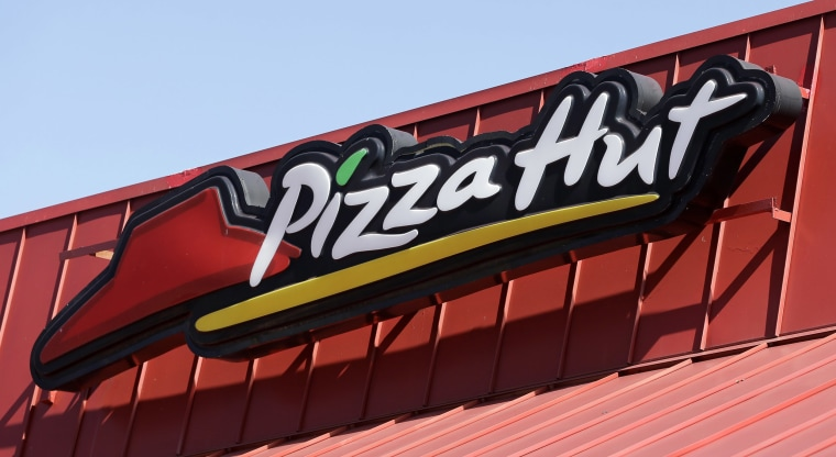 Image: A Pizza Hut sign at a restaurant in Miami.