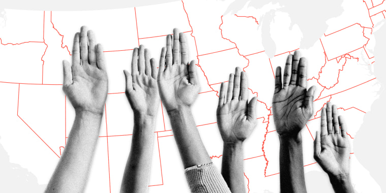 Image: A group of raised hands in front of a United States map.