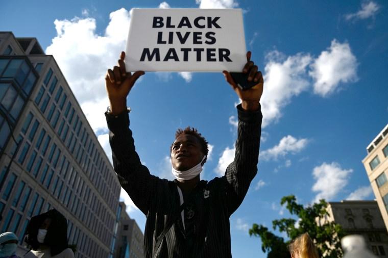 Image: US-POLITICS-RACISM-UNREST