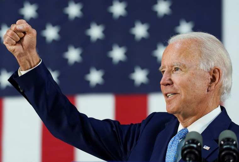 Image: Democratic presidential candidate Joe Biden thrusts his fist while answering questions from reporters during a campaign event in Wilmington,