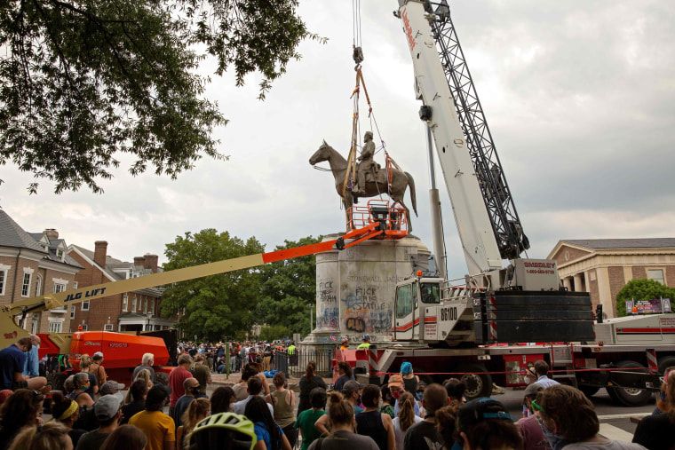 The Stonewall Jackson statue is removed from Monument Avenue in Richmond, Va., on July 1, 2020.