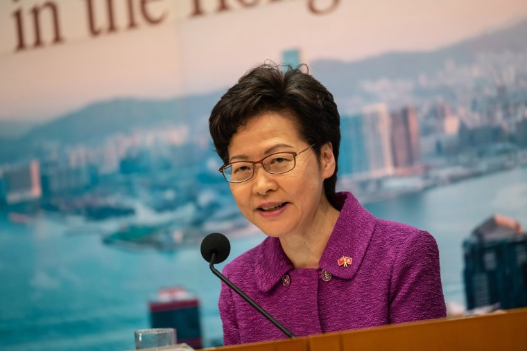Image: Hong Kong's Chief Executive Carrie Lam takes part in a press conference at the government headquarters, on the 23rd anniversary of the city's handover from Britain to China,