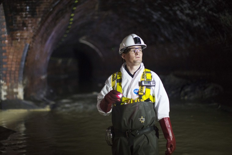 Image: An operations manager inside a sewer in London.