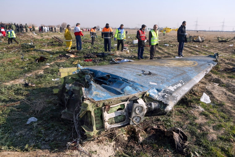 Rescue teams survey the scene of a Ukrainian airliner that crashed shortly after take-off near Imam Khomeini airport in Tehran, Iran, on Jan. 8, 2020.