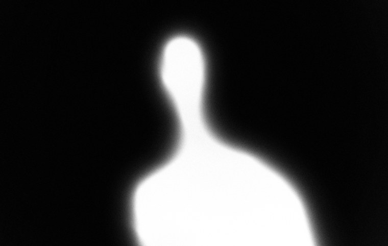 Image: A glowing white humanoid figure on a black background.