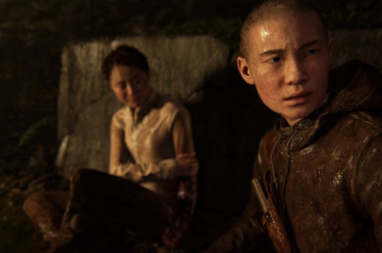 Ian Alexander plays Lev, right, one of the first transgender video game characters to be prominently featured in a triple-A video game.