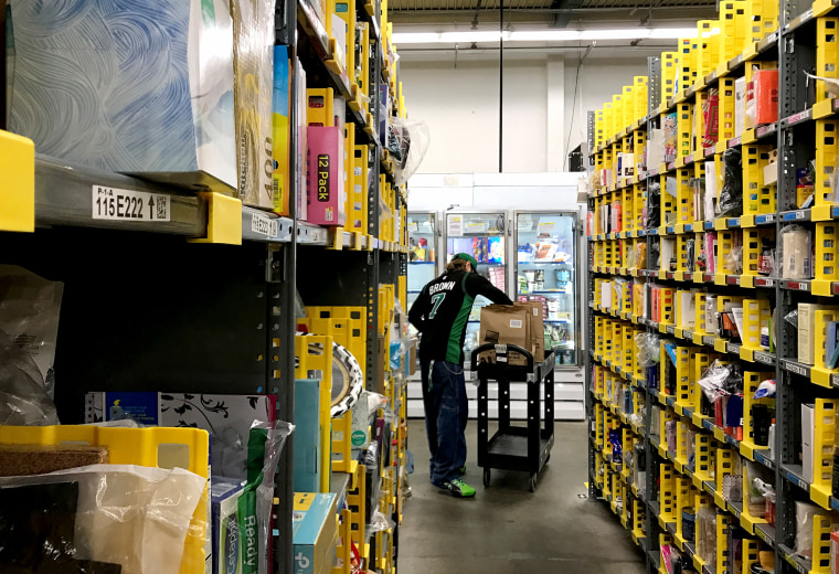 An employee collects items ordered by Amazon.com customers through the company's two-hour delivery service Prime Now in a warehouse in San Francisco