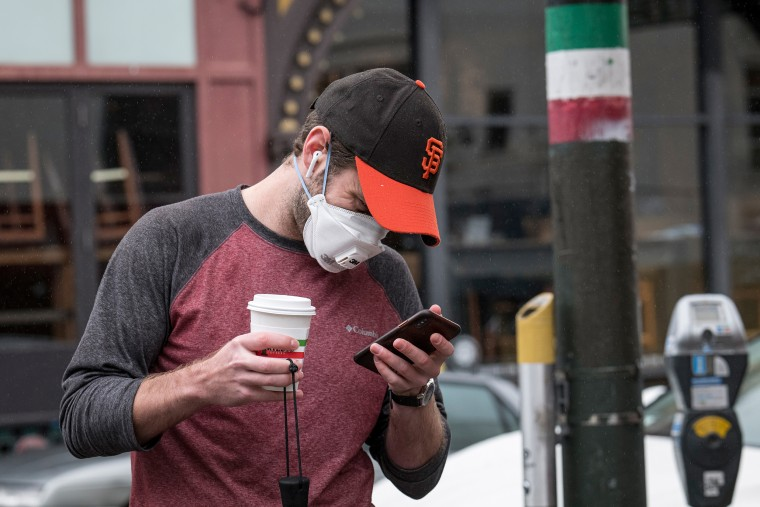 Image: Cellphone mask user