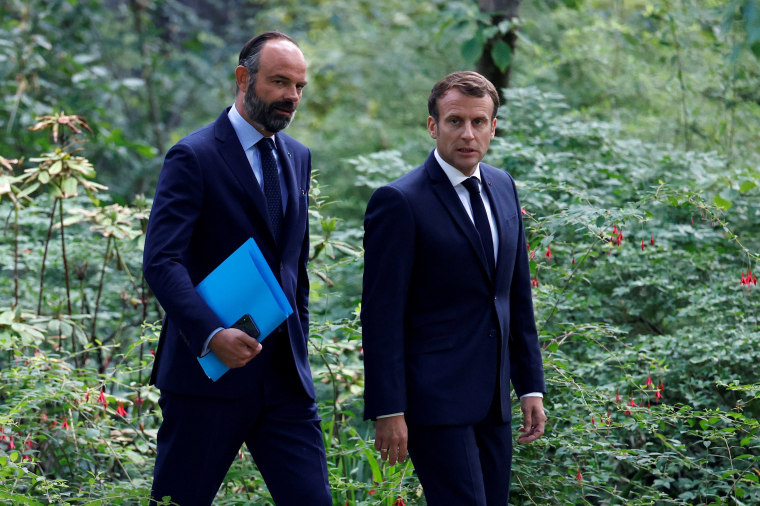 Image: French President Emmanuel Macron and French Prime Minister Edouard Philippe arrive for a meeting at the Elysee Palace in Paris