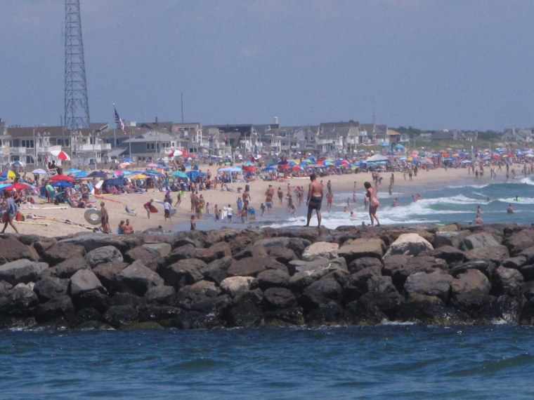 Image: A large crowd fills the beach in Manasquan, N.J.