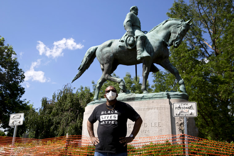 Don Gathers stands in front of a statue depicting Robert E. Lee during a racial justice protest in Charlottesville, Va., on May 30, 2020.