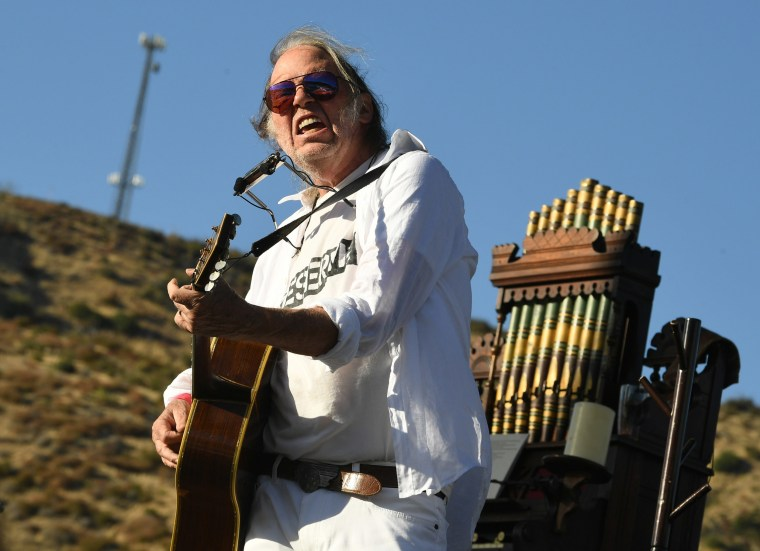 Image: Neil Young performs at Painted Turtle Camp in Lake Hughes, California.