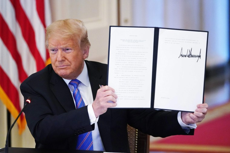 """Image: President Donald Trump holds an executive order on """"Continuing the President's National Council for the American Worker and the American Workforce Policy Advisory Board"""" in the East Room of the White House on June 26, 2020."""