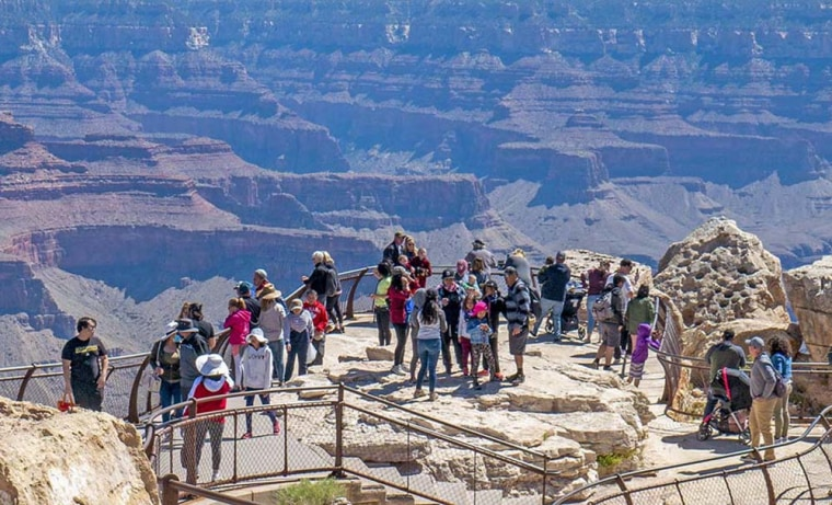 Image: When visiting the park, it is best to avoid crowded areas and find locations that allow for adequate social distancing.