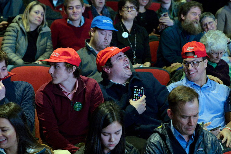 Image: Students laugh white waiting for the next speaker at the New Hampshire Youth Climate and Clean Energy Town Hall in Concord, New Hampshire.