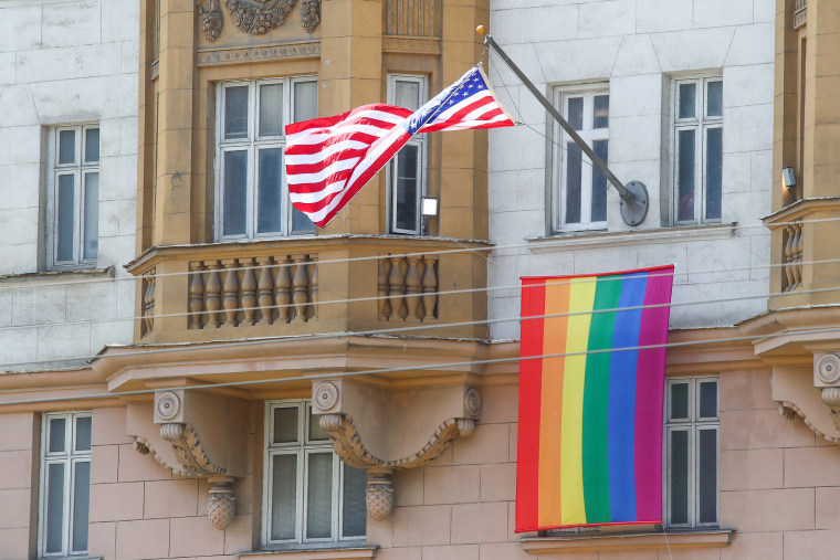 Image: The U.S. national flag and an LGBT pride flag hoisted on the front facade of the U.S. Embassy in Moscow.