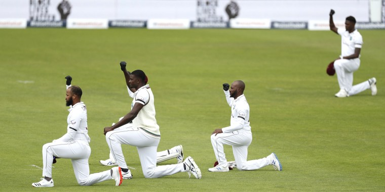 West Indies cricketers take a knee before the start of the first day of the 1st cricket Test match against England in Southampton on Wednesday.
