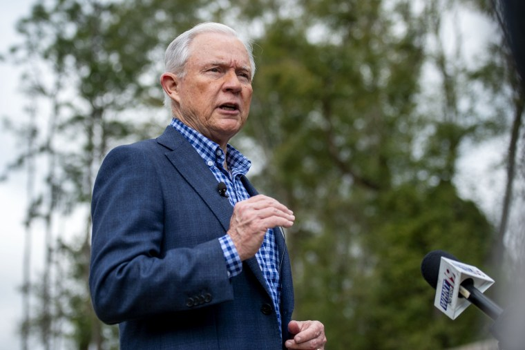 Image: Jeff Sessions speaks to reporters after voting in Alabama's primary election in Mobile on March 3, 2020.