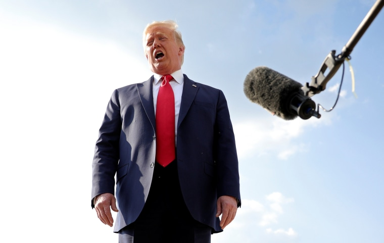 Image: President Donald Trump speaks to reporters before boarding Air Force One for travel to Mount Rushmore from Washington