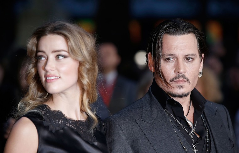 "Image: Amber Heard and Johnny Depp attend the ""Black Mass"" Virgin Atlantic Gala screening in London, England."