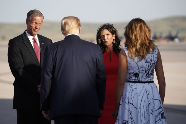 Image: Sen. John Thune, R-S.D., and Gov. Kristi Noem greet President Donald Trump and first lady Melania Trump upon arrival at Ellsworth Air Force Base