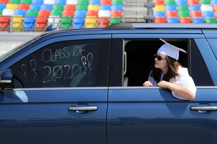 Image: Graduates of Matanzas High School receive their diplomas on the track in their cars at Daytona International Speedway