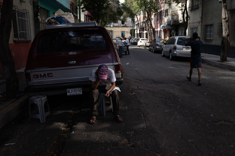 Image: Juan Rodr?guez Molina, 32, sits next to a sidewalk in the Buenavista neighborhood on June 19, 2020 in Mexico City, Mexico