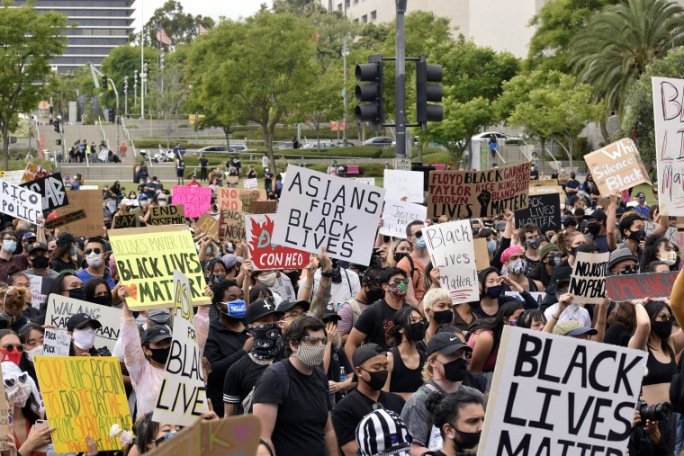 An estimated 1,000 Asian Americans rallied at an AAPI for Black Lives march at Los Angeles City Hall on June 5.